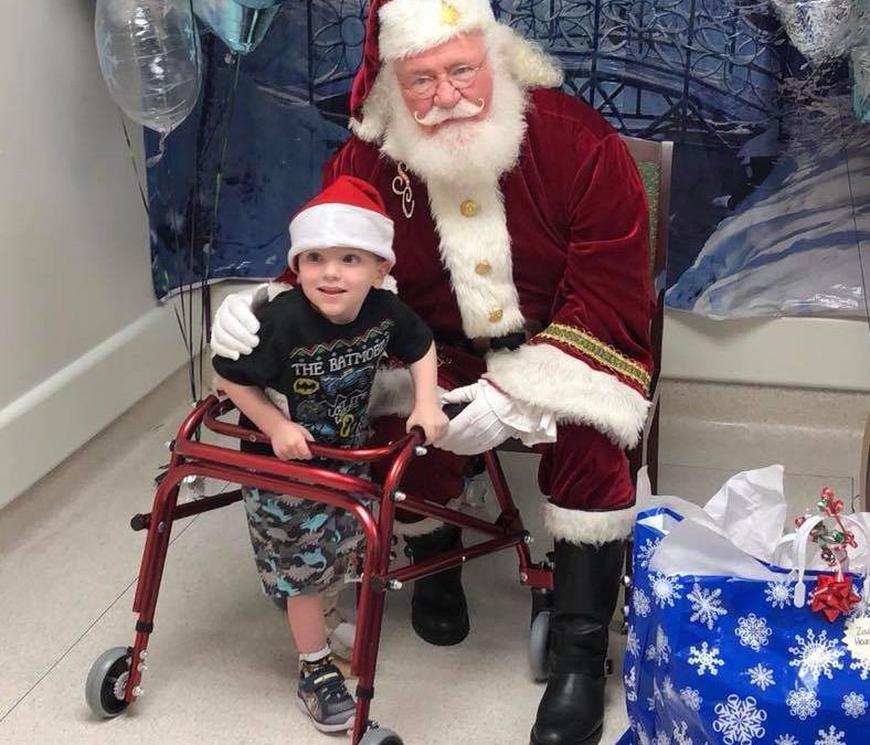 Santa Delivers at Paley Institute Holiday Party